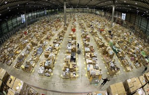 Workers are seen in the Amazon.co.uk warehouse in Milton Keynes, north of London November 17, 2006. REUTERS/Dylan Martinez (BRITAIN) - RTR1JFO4